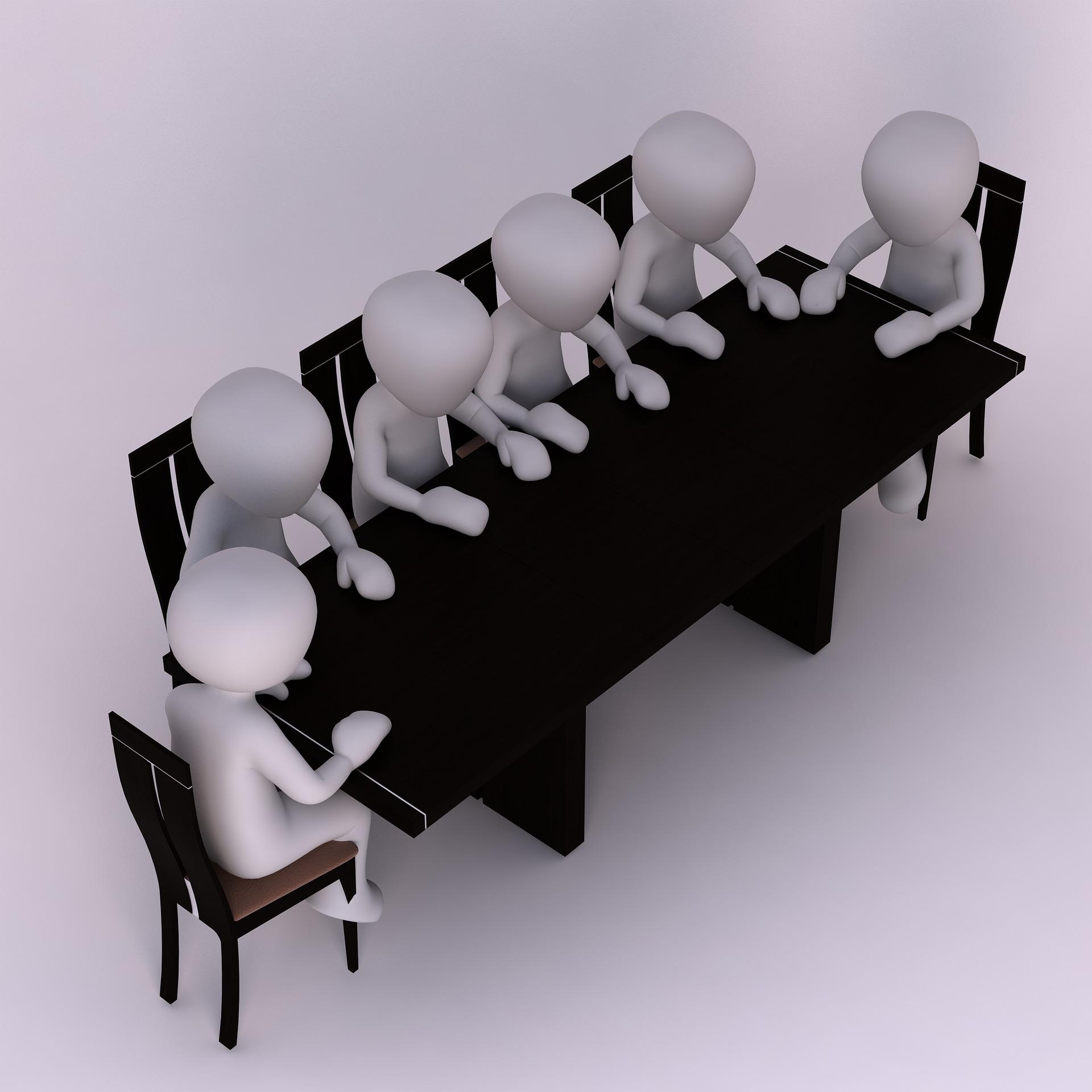 grafika przedstawiająca osoby siedzące przy stole konferencyjnym